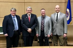 Sen. Bill Weber poses with representatives from truShrimp following a committee hearing in February, 2017
