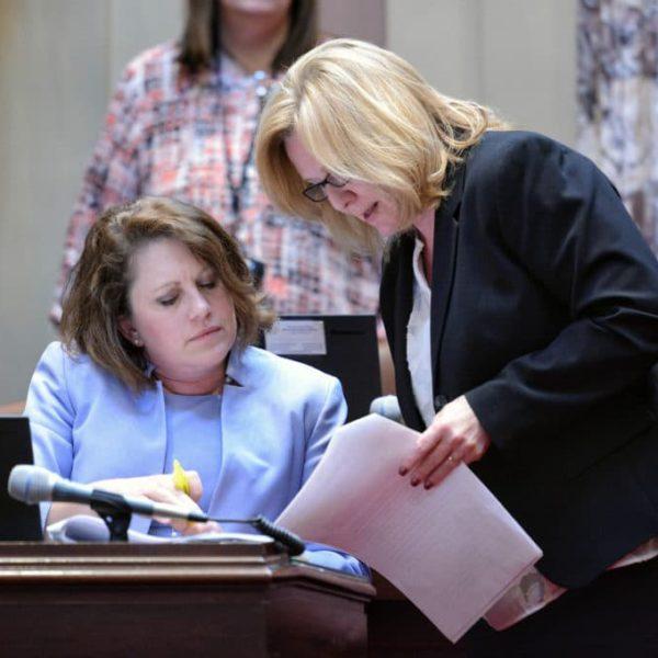 Sen. Michelle Benson (Ham Lake), left, speaks with Sen. Michelle Fischbach (Paynesville), right.