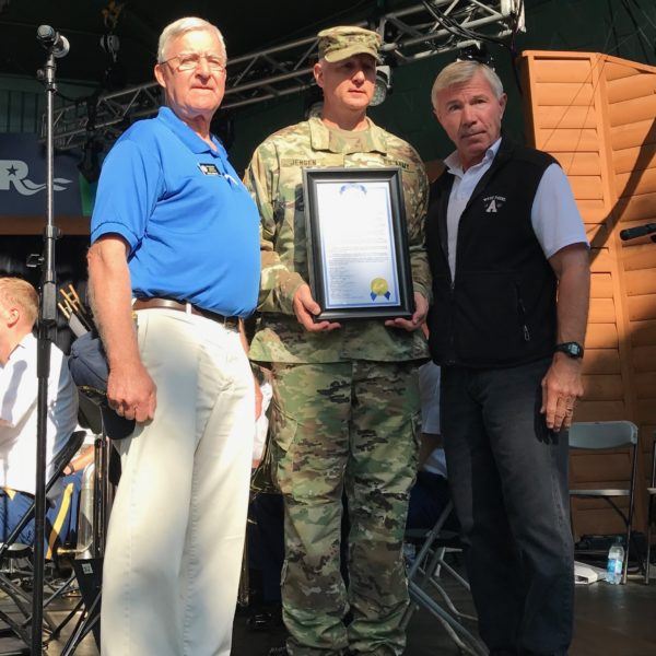 Sen. Bruce Anderson and Rep. Bob Dettmer present Maj. Gen. Jensen with resolution